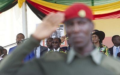 In this Saturday, Feb. 25, 2017 file photo, President Robert Mugabe, center, and his wife Grace, right, attend his 93rd birthday celebrations in Matopos on the outskirts of Bulawayo, Zimbabwe. (AP/Tsvangirayi Mukwazhi)