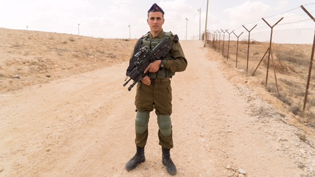 A soldier poses with new equipment he received as part of army program unveiled on March 7, 2017. (IDF Spokesperson's Unit)