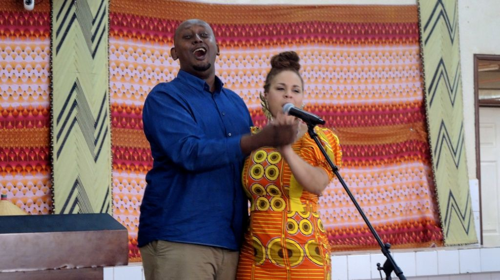 Jean Claude Nkulikiyimfura (left), the executive director of Agahozo Shalom Youth Village, goofs around during a music show for the students on February 17, 2017. (Melanie Lidman/Times of Israel)