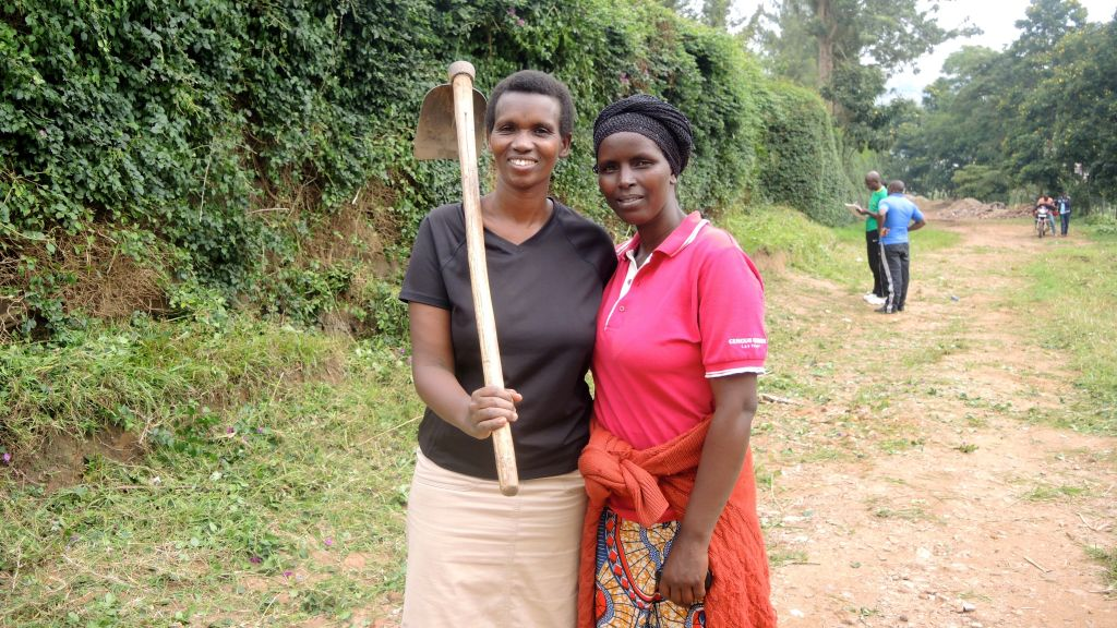 Yvonne Nshuti, left, with a neighbor during the monthly Umuganda community service day in Kigali, Rwanda on February 25, 2017. (Melanie Lidman/Times of Israel)