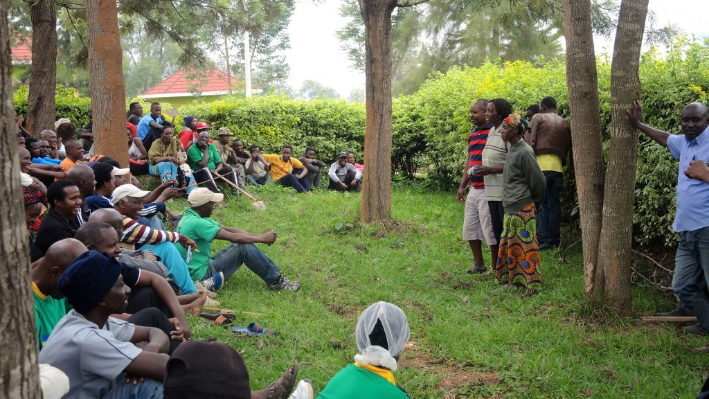After three hours of weeding and pruning a dirt path, the residents of Kimana Village in Kigali, Rwanda gathered for an hour-long community meeting on February 25, 2017. (Melanie Lidman/Times of Israel)