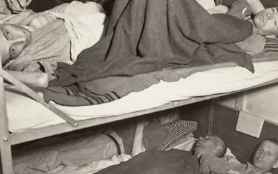 Illustrative image of Holocaust survivors in a hospital ward after liberation, circa April 29 - May 1945, in Dachau, Germany (United States Holocaust Memorial Museum, courtesy of Francis Robert Arzt)