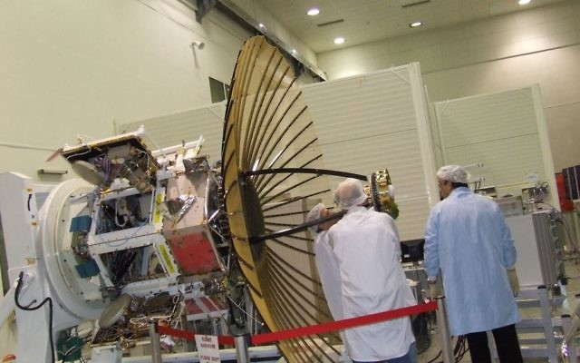 Workers next to the IDF/AF TECSAR, an advanced imaging satellite produced by IAI (IAI via Tsahi Ben-Ami / Flash90)