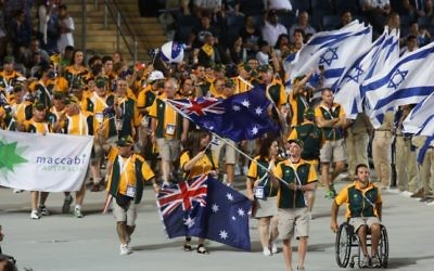 Athletes from the Australian delegation wave their national flags during the opening ceremony of the Maccabiah Games in Jerusalem, Israel, July 18, 2013. (Yonatan Sindel/Flash90)