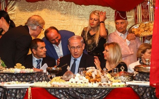Prime Minister Benjamin Netanyau and his wife Sara attend the Jewish Moroccan celebration of Mimouna, in Or Akiva on April 21, 2014. (Avishag Shaar Yashuv/Pool/Flash90)