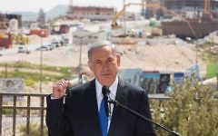 Prime Minister Benjamin Netanyahu gives a statement to the press during a visit to the East Jerusalem neighborhood of Har Homa on March 16, 2015. (Yonatan Sindel/Flash90)