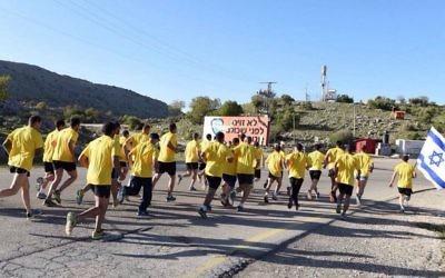 Illustrative: Golani Brigade soldiers participate in the Golani Brigade Race on April 26, 2015. (IDF Spokesperson/Flash90)