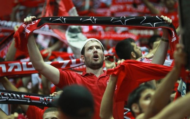 Hapoel Jerusalem fans cheer during a match, illustrative (Yonatan Sindel/Flash90)