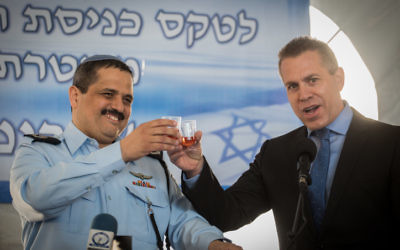 Illustrative: Incoming Israeli Chief of Police Roni Alsheikh and Minister of Internal Security Gilad Erdan toast at the welcoming ceremony held in Alsheikh's honour, at the National Police Headquarters in Jerusalem, on December 03, 2015. Photo by Hadas Parush/FLASH90