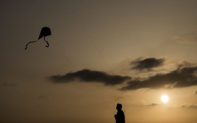 Illustrative photo of a person flying a kite. (Yonatan Sindel/Flash90)