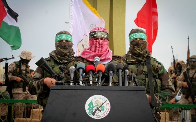 Abu Ubaida, spokesman of the Izz ad-Din al-Qassam Brigades, the military wing of the Palestinian Islamist movement Hamas, speaks during a memorial in the southern Gaza Strip town of Rafah on January 31, 2017. (Abed Rahim Khatib/ Flash90)