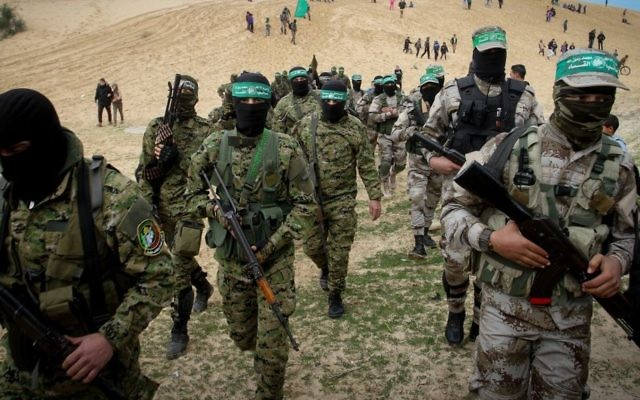 Members of the Izz ad-Din al-Qassam Brigades, the military wing of the Palestinian Islamist terror group Hamas, attend a memorial in the southern Gaza Strip town of Rafah on January 31, 2017. (Abed Rahim Khatib/Flash90)