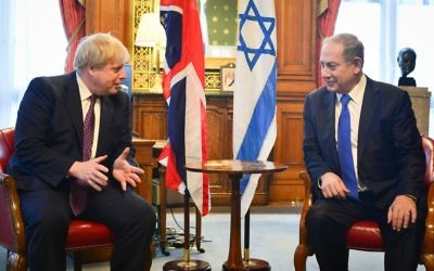 Israeli prime minister Benjamin Netanyahu (R) meets with British Foreign Secretary Boris Johnson in London, United Kingdom. PM Netanyahu is on official state visit. February 06, 2017. (Kobi Gideon/GPO)