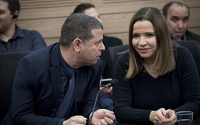 Zionist Camp party members Shelly Yachimovich (R) and Eitan Cabel attend at a faction meeting in the Knesset on February 6, 2016. (Yonatan Sindel/Flash90)