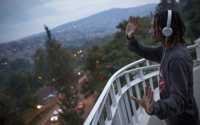 """A hip hop instructor who goes by the stage name of """"Poppin Chris"""" dances on the roof of Impact Hub in Kigali, Rwanda, on February 15, 2017. (Miriam Alster/Flash90)"""