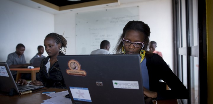 "Gladys Inabeza, right, working in K-Lab in Kigali, Rwanda on February 16, 2017. Inabeza is developing an app called called ""Hitamo"" which means ""to choose"" in Kinyarwanda, a local version of Yelp. (Miriam Alster/Flash90)"