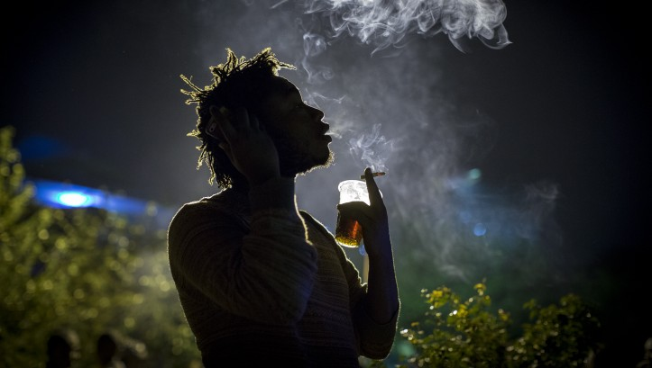 An artist takes a cigarette break during the weekly Thursday Happy Hour concert at the Inema Arts Center in Kigali, Rwanda on February 17, 2017. (Miriam Alster/Flash90)