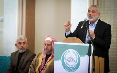 Yahya Sinwar (L) the new leader of Hamas in the Gaza Strip and senior political leaders of the Islamist movement Hamas Khalil al-Haya (C) Ismail Haniyeh (R) attend the opening of a new mosque in Rafah town in the southern Gaza Strip on February 24, 2017. (Abed Rahim Khatib/ Flash90)