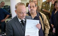 Yoram Sheftel, defense attorney for convicted manslaughterer Elor Azaria, and Azaria's father Charlie speak at a press conference on March 1, 2017 appealing Elor's jail sentence. (FLASH90)