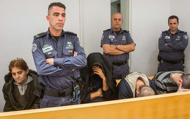 Employees of a nursing home in Haifa seen in the Haifa Magistrate's Court, where they were charged with elder abuse on March 5, 2017. (Flash90)