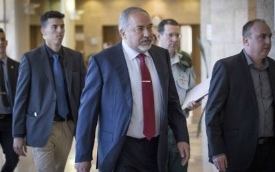 Defense Minister Avigdor Liberman arrives to the Defense and Foreign Affairs Committee meeting at the Knesset, on March 6, 2017. (Yonatan Sindel/Flash90)