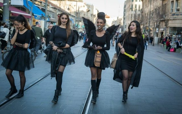 Israeli girls dressed up in costumes walk on Jaffa Road ahead of the Jewish holiday of Purim, in Jerusalem, on March 8, 2017. (Hadas Parush/Flash90)