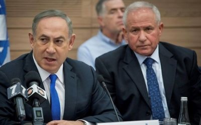 Prime Minister Benjamin Netanyahu (L) and Likud MK Avi Dichter (R) attend a Knesset Foreign Affairs and Defense Committee meeting on March 8, 2017. (Yonatan Sindel/Flash90)