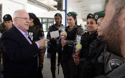 President Reuven Rivlin gives Purim packages (Mishloach Manot) to members of the Israeli security forces guarding at the Ofer checkpoint on March 12, 2017. (Mark Neyman/GPO)