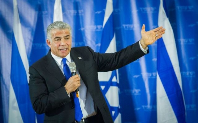 Yesh Atid leader Yair Lapid speaks during a meeting with party supporters in Netanya, March 19, 2017. (Flash90)