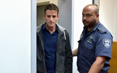 Yair Katz (L), son of Welfare Minister Haim Katz (Likud), at a remand hearing at the Rishon Lezion Magistrate's Court, March 22, 2017. (Flash90)