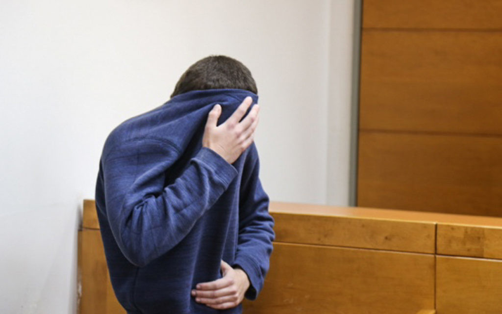 A man brought for a court hearing at the Rishon Lezion Magistrate's Court, under suspicion of issuing fake bomb threats against Jewish institutions around the world, March 23, 2017. (Flash90)