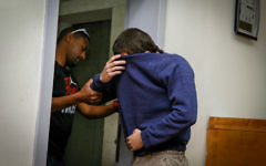 An Israeli-American Jewish teenager, accused of making dozens of anti-Semitic bomb threats in the United States and elsewhere, in a courtroom in Rishon Lezion on March 23, 2017. (Flash90)