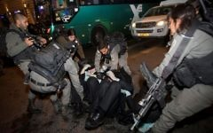 Israeli police officers clash with ultra-Orthodox Jewish men during an anti-draft protest in Jerusalem on March 23, 2017. (Yonatan Sindel/Flash90)