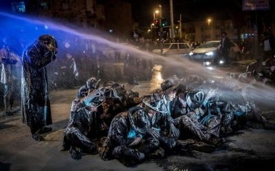 Police use a water cannon to disperse demonstrators during ultra-Orthodox anti-draft protests in Jerusalem on March 23, 2017. (Yonatan Sindel/Flash90)