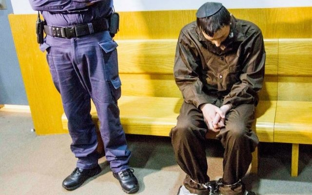 Meir Ephraim Goldstein, suspected of beheading his wife in burning her body in Tiberias, is seen at the Nazareth Magistrate's Court as he arrives for a hearing on March 30, 2017. (Flash90)