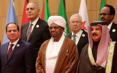 Omar al-Bashir, center, president of Sudan, stands between Egyptian president Abdel Fattah el-Sisi, left, and Bahrain's King Hamad bin Isa Al Khalifa at the annual Arab League summit on Wednesday, March 29, 2017 held this year on the Dead Sea in Jordan.  (AP Photo/ Raad Adayleh)