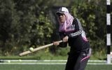 In this Sunday, March 19, 2017 photo, Palestinian coach, Mahmoud Tafesh, gives instructions before starting training for an all women's baseball game, on a soccer field in Khan Younis, southern Gaza Strip. (AP Photo/Khalil Hamra)