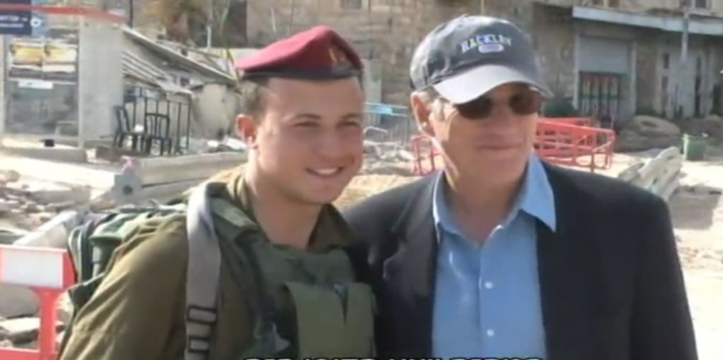 Richard Gere poses for a photo with a soldier in the West Bank city of Hebron, March 13, 2017. (Screen capture: Channel 2)