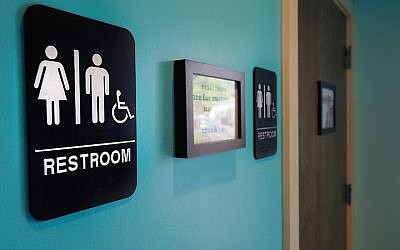 Unisex signs hang outside bathrooms at Toast Paninoteca on May 10, 2016 in Durham, North Carolina. ( Sara D. Davis/Getty Images via JTA)