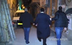 Screen capture from video showing police arresting ultra-Orthodox men on suspicion of sex crimes against women and children, March 27, 2017. (Police spokesperson)