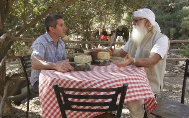 Chef Michael Solomonov (left) tastes cheeses made by Shai Seltzer in the Judaean Hills. Seltzer ages his cheeses in a cave that dates back to Second Temple times. (Florentine Films)