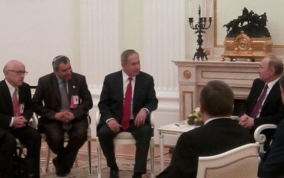 Prime Minister Benjamin Netanyahu (center) meets with Russian President Vladimir Putin in Moscow (right) on Thursday, March 9, 2017 (Israeli embassy in Moscow)