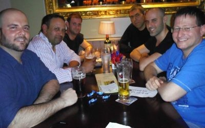 Celebrating Purim in a Dublin pub are Israelis (from left) Elad Michaely, Itamar Sinai, Michael Dulberg, Arik Warshager, Mattan Lass and Oren Shpigel. Sinai and Warshager have lived in Ireland for 17 and 14 years, respectively, and give advice to the newcomers. (Michael Riordan/Times of Israel)