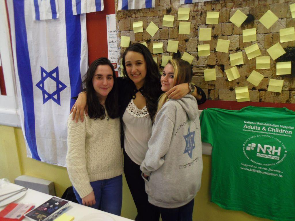Sonia Tagamlitsky, Sara Epstein and Louiza Vasiliu at the mini Western Wall. (Michael Riordan/Times of Israel)