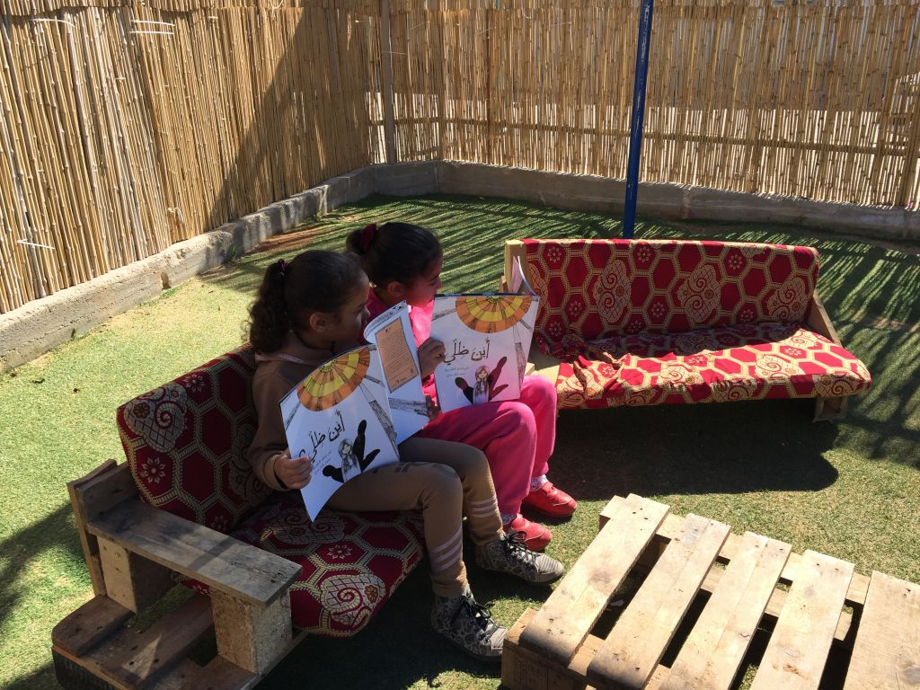 Reading 'xxxx', a Maktabat al-Fanoos book at a Lod kindergarten (Jessica Steinberg/Times of Israel)