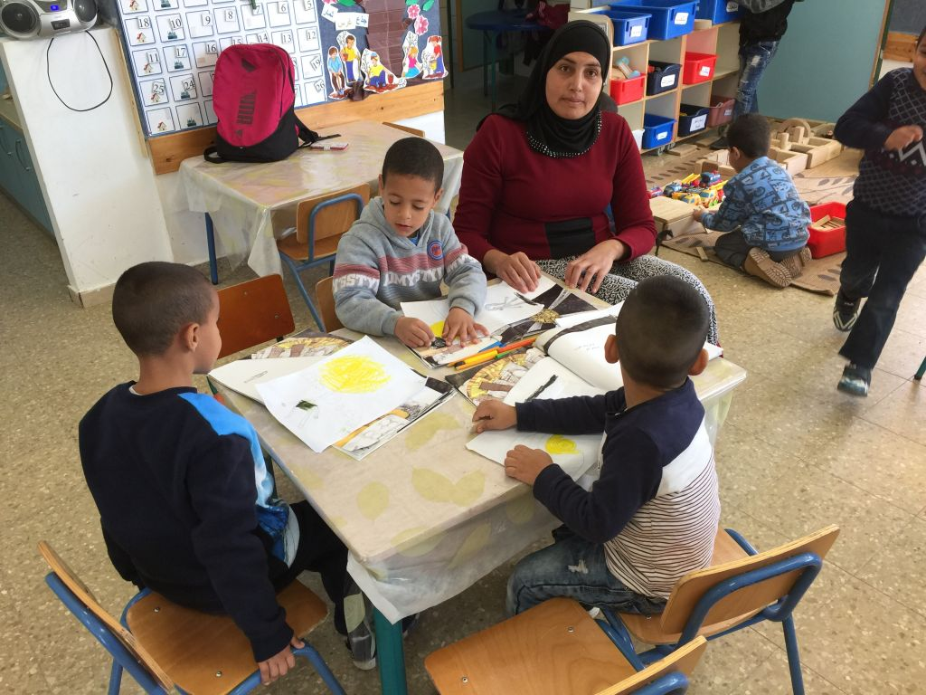 Working on artwork related to Malak Farooge's Lantern Library book, ' Where Do I Go When I Am Angry' at the Lod kindergarten (Jessica Steinberg/Times of Israel)