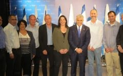 Yesh Atid chairman Yair Lapid (4th from right) surrounded by MKs from his party and seven regional council heads who have joined Yesh Atid, March 7, 2017. (Courtesy)