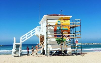 A view of Tel Aviv's pop-up lifeguard tower hotel (under construction) that will be open for 10 days only this March (Jessica Steinberg/Times of Israel)