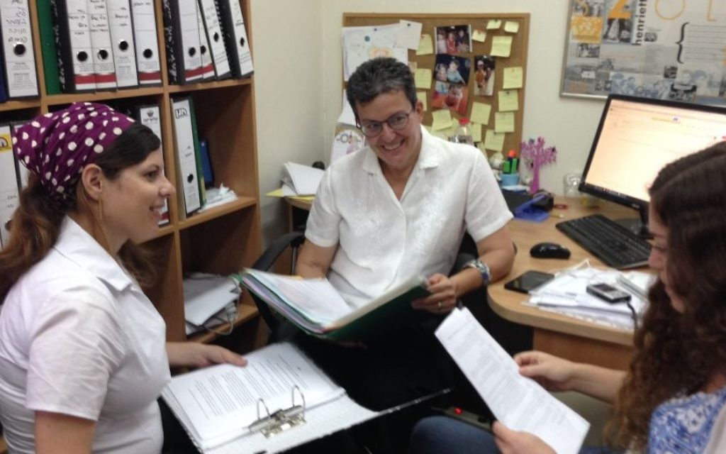 Dr. Susan Weiss (center), head of the Center for Women's Justice, sits with staff in its Jerusalem offices. (courtesy)