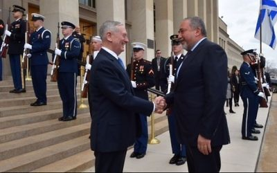 US Secretary of Defense James Mattis (L) greets Defense Minister Avigdor Liberman upon his arrival at the Pentagon on March 7, 2017. (Courtesy: Ariel Hermoni/Defense Ministry)